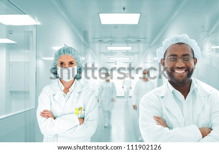 Scientists team at modern hospital lab, group of doctors - stock photo