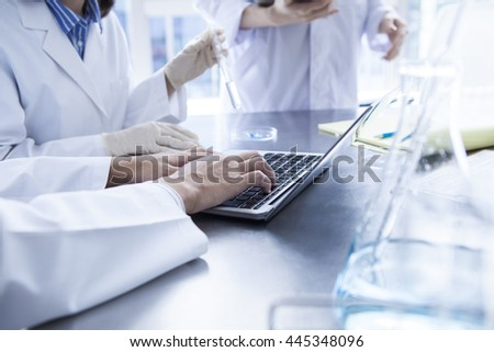 Scientists to the meeting gathered in the lab. - stock photo