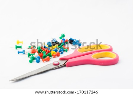 scissor and colorful pin on white background