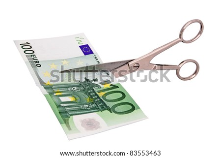 scissors about to cut a banknote - stock photo