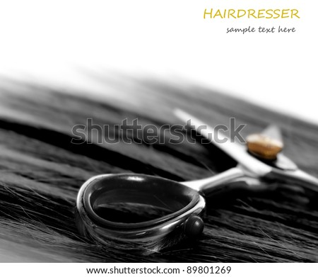 scissors and lock of hair. selective focus - stock photo