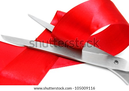 Scissors and red tape. On a white background. - stock photo