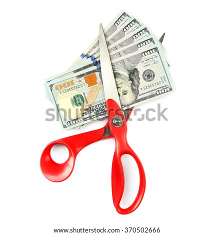 Scissors cut dollar banknotes, isolated on white - stock photo
