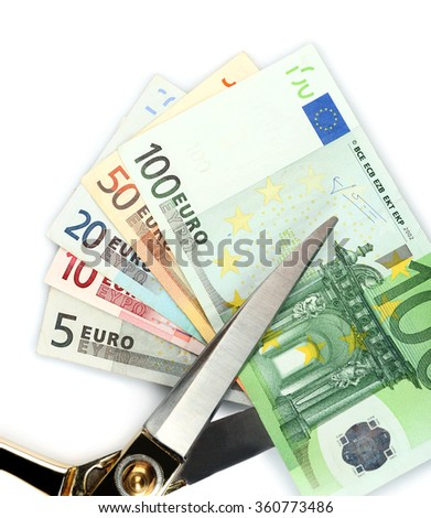 Scissors cut euro banknotes, isolated on white - stock photo