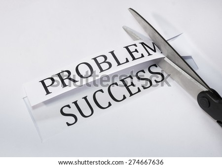 Scissors cutting paper with problems word and success word is in under.(Concept of success overcoming problems. ) - stock photo