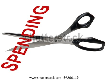 Scissors cutting the word spending as a metaphor - stock photo
