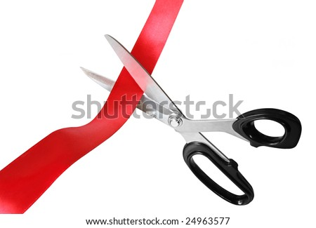 Scissors cutting through red ribbon or tape, isolated on white.