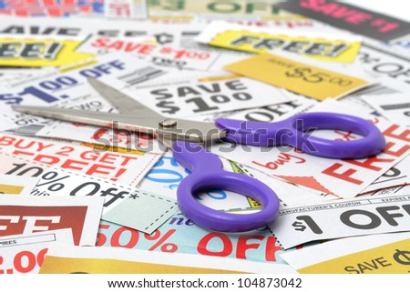 scissors with grocery coupons - stock photo