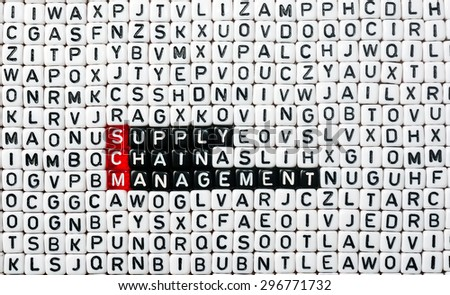 SCM Supply Chain Management written on black and white  dices  - stock photo