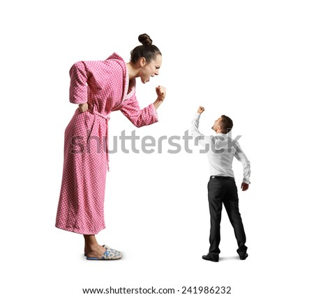 scold wife screaming and fist, small husband looking at his wife and showing fist. isolated on white background - stock photo