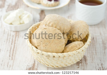Scone of whole wheat in a wicker basket for breakfast horizontal - stock photo