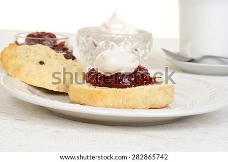scone with jam and cream - stock photo