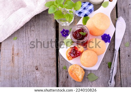 scone with strawberry jam, tea party , afternoon tea , buttermilk biscuits. Selective focus - stock photo