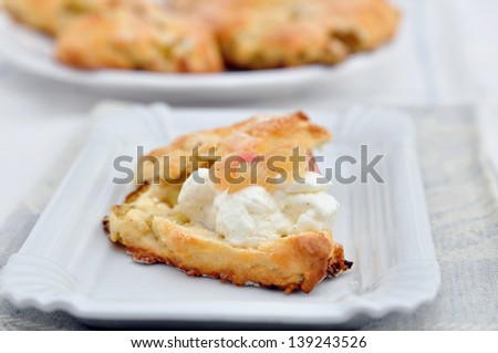 Scones with clotted cream and rhubarb - stock photo