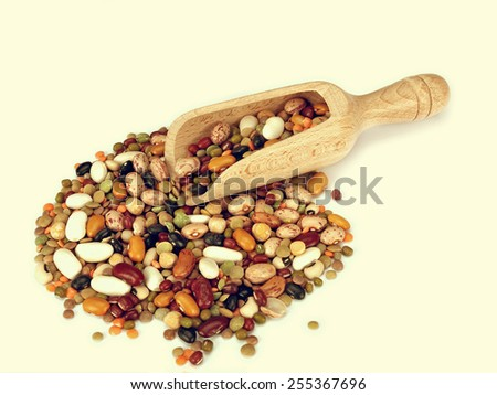 Scoop of beans, peas, lentils. Retro filtered colours. Healthy food. - stock photo