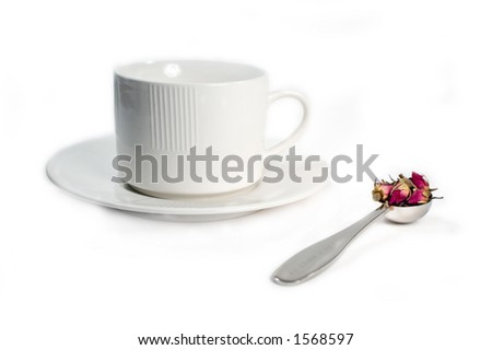 Scoop of tea and teacup/saucer isolated on white - stock photo