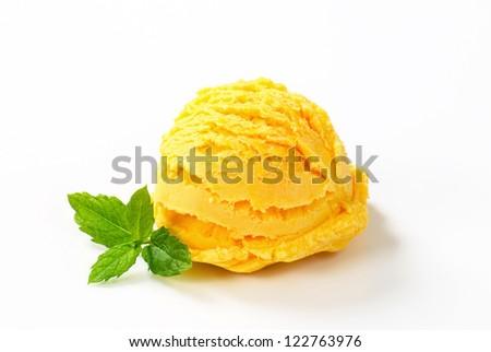 Scoop of yellow ice cream isolated on white - stock photo