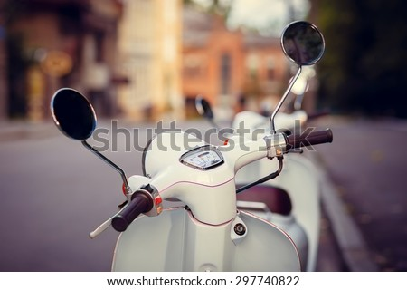 Scooter stands on the old street - stock photo