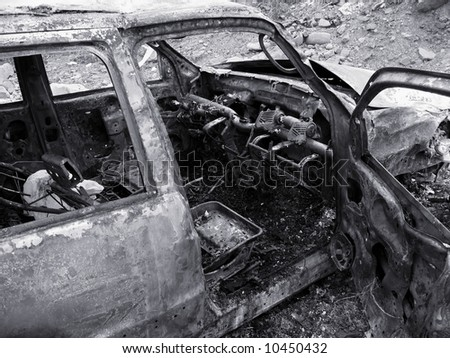 Scorched Car Wreck -- the result of a serious car accident