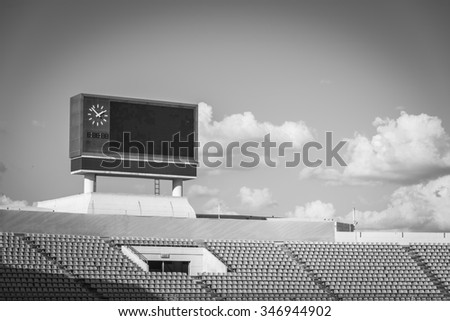 score board at football stadium with bluesky ,  black and white - stock photo