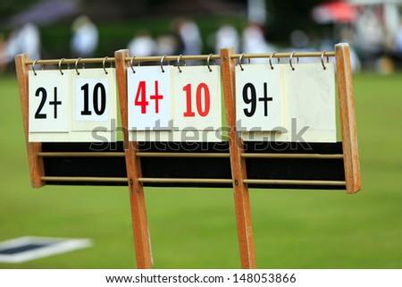 Scoreboard at a lawn bowls match - stock photo