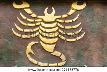 Scorpio sign of horoscope on the wall - stock photo