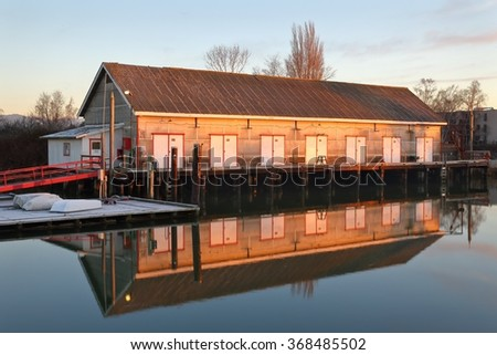 Scotch Pond Net Shed, Steveston, BC. A frosty morning at the Net Shed in Steveston's Scotch Pond, a former cannery location. British Columbia, Canada. - stock photo