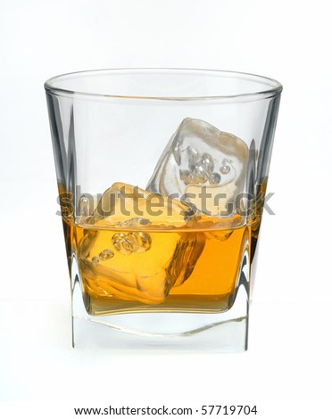 scotch whisky in glass with ice cubes