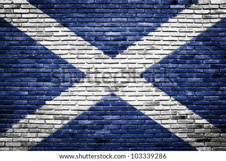 scotland flag painted on old brick wall texture background - stock photo