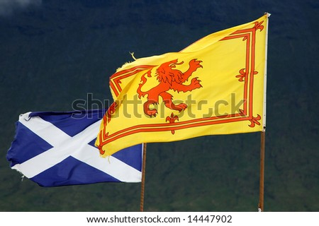 Scottish flags - The royal flag and St Andrew's Cross - stock photo