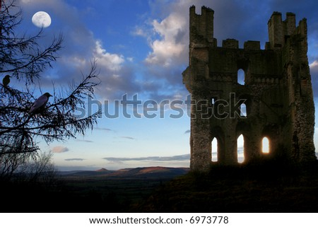 Scottish Haunted Tower at Dusk with Moon and rolling Hills in background, glowing shafts of light through lower windows and Crows nesting in turret and in Fir Tree in forground - stock photo
