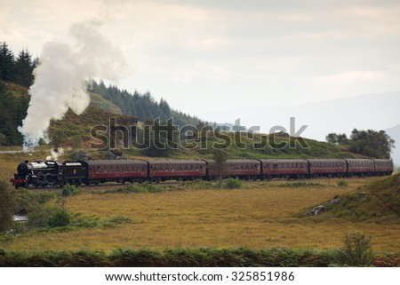 SCOTTISH HIGHLANDS, SCOTLAND â?? AUGUST 14: The Jacobite steam train travelling through the Scottish Highlands, between Fort William and Mallaig on August 14, 2014 - stock photo