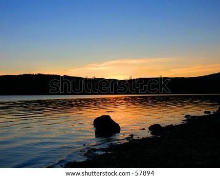 Scottish Loch at sunset - stock photo