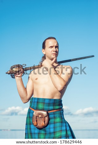 Scottish man with sword  - stock photo