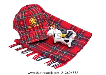 Scottish Red tartan cap, tartan scarves and highland cattle Isolated on White - stock photo