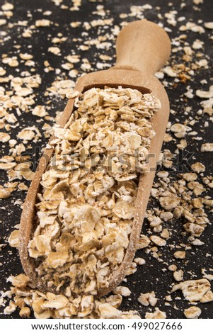 scottish toasted oats in a wooden scoop on slate
