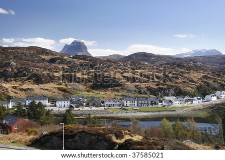 Scottish village of Lochinver on a sunny spring day with Suilven behind - stock photo