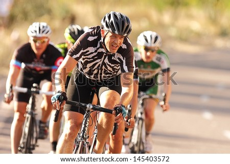 SCOTTSDALE, AZ - MAY 19: Brett Van De Sande competes in the Criterium at DC Ranch, a high-speed circuit race on a 1-kilometer closed course on May 19, 2013 in Scottsdale, AZ.  - stock photo