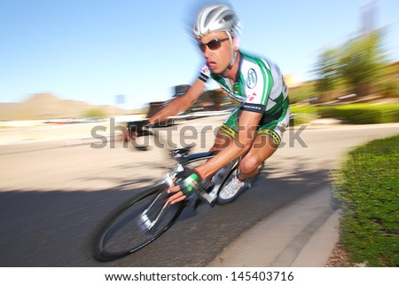 SCOTTSDALE, AZ - MAY 19: Mark Aasmundstad competes in the Criterium at DC Ranch, a high-speed circuit race on a 1-kilometer closed course on May 19, 2013 in Scottsdale, AZ.  - stock photo