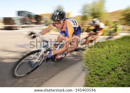 SCOTTSDALE, AZ - MAY 19: Tyler Coplea competes in the Criterium at DC Ranch, a high-speed circuit race on a 1-kilometer closed course on May 19, 2013 in Scottsdale, AZ.  - stock photo
