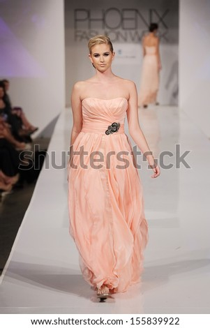 SCOTTSDALE, AZ - OCTOBER 6: Models showcasing designs from the Enzoani collection during a runway show at the Phoenix Fashion Week on October 6, 2012 in Scottsdale, Arizona.  - stock photo