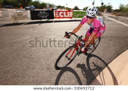 SCOTTSDALE, AZ - OCTOBER 2: Women cyclists compete in the Scottsdale Cycling Festival Criterium, a high-speed circuit race on a 1-kilometer closed course in Scottsdale, AZ on October 2, 2010. - stock photo