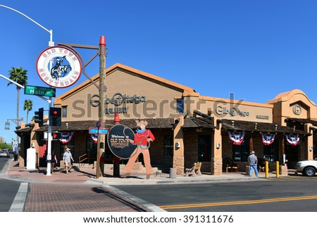 SCOTTSDALE, AZ, USA - FEBRUARY 26, 2016:  The Gilbert Ortega Gallery, specializing in Native American art and jewelry, at Scottsdale and Main with the iconic Welcome to Old Town Scottsdale sign. - stock photo
