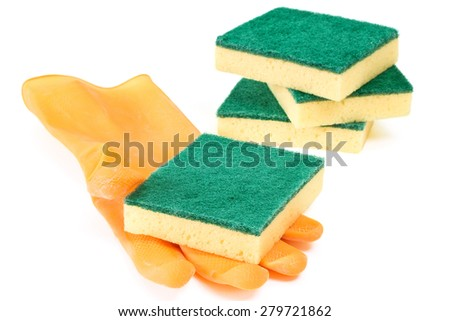 Scouring sponges with rubber glove on white background - stock photo
