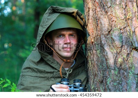 Scout in helmet in summer forest