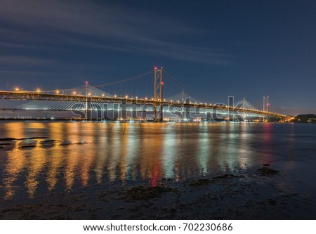 SCOZIA, QUEENSFERRY - AUGUST 08, 2017 - Night view of the harbor in the city of Edinburgh, with illuminated bridges and moored boats