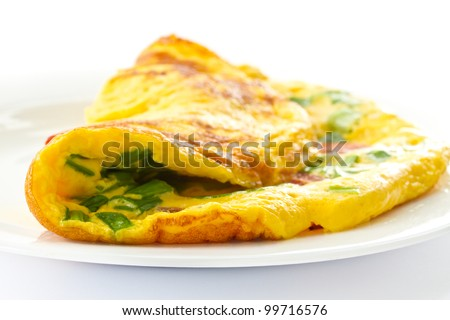 scrambled eggs with fresh herbs on a white background - stock photo