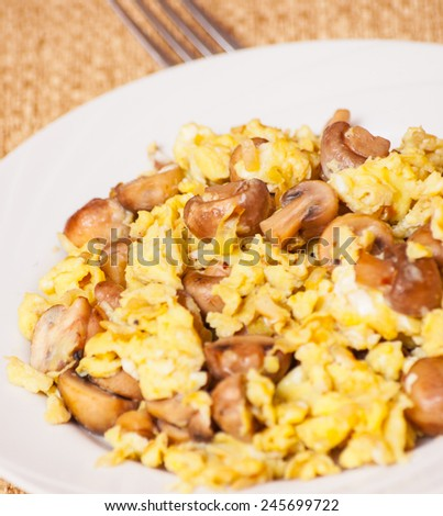 scrambled eggs with mushrooms - stock photo