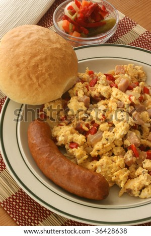 scrambled eggs with organic tomato and sausage