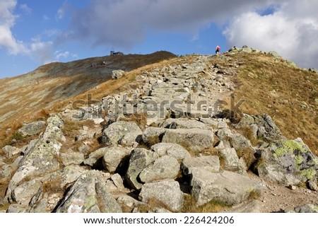 Scrambler on the top of mountain. High Tatra Mountains. - stock photo